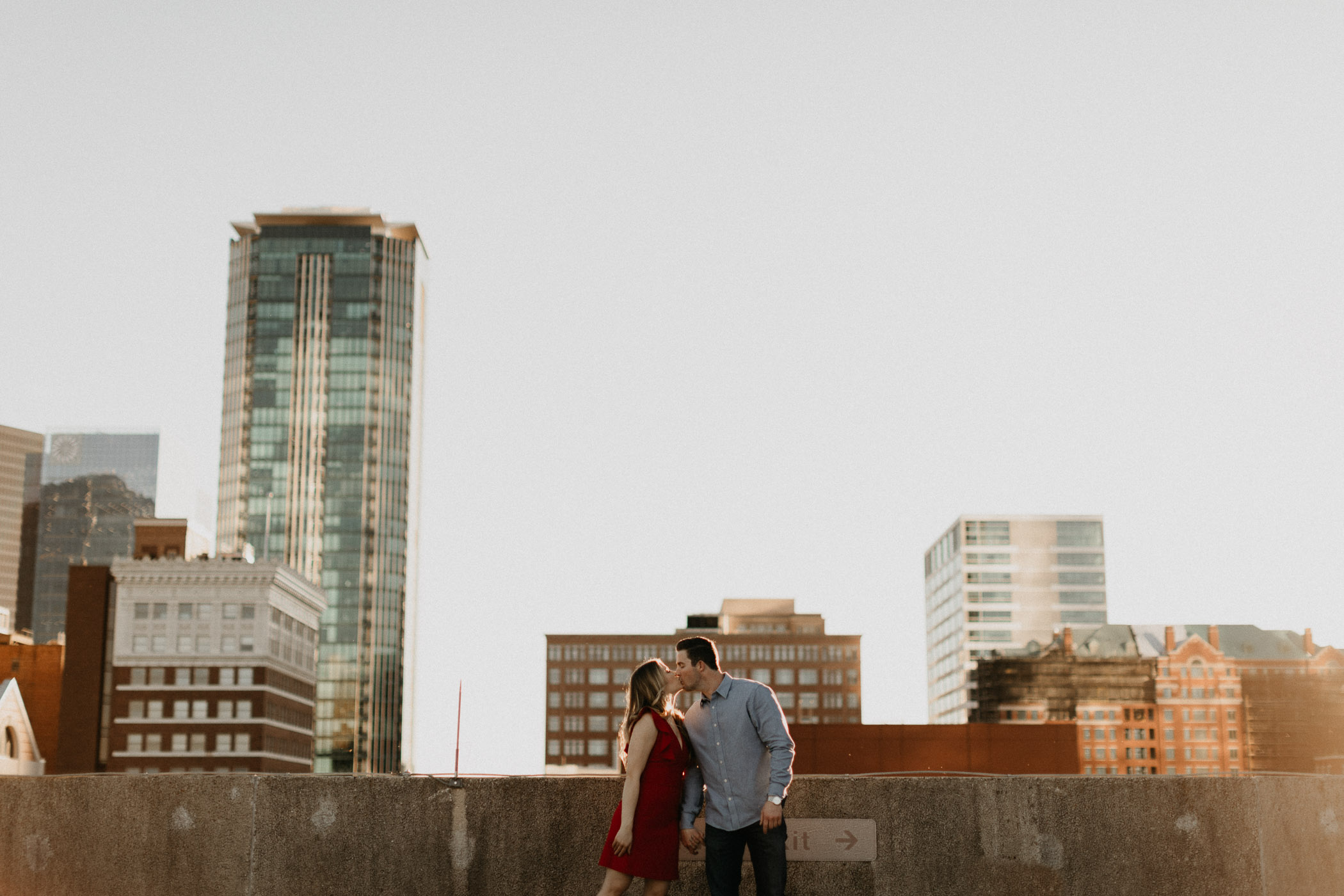 landscape photo of couple with skyscrapers in downtown Fort Worth