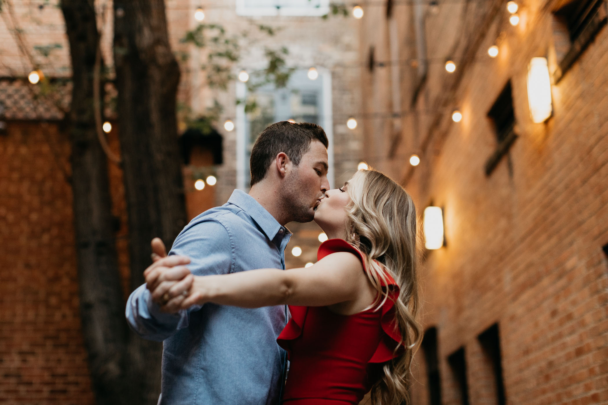 Fort Worth court yard engagement photos with string lights