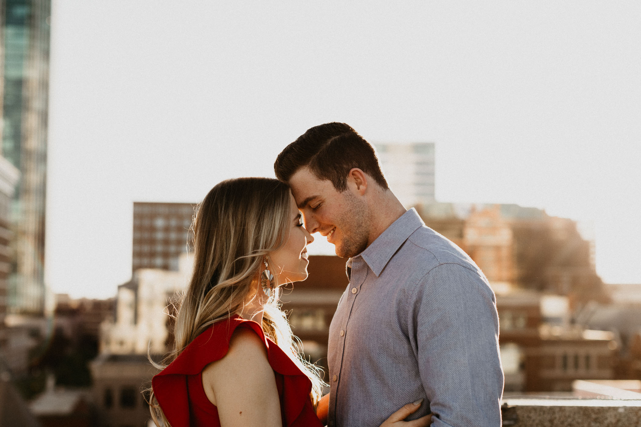 Rooftop photography at sunset of engaged couple