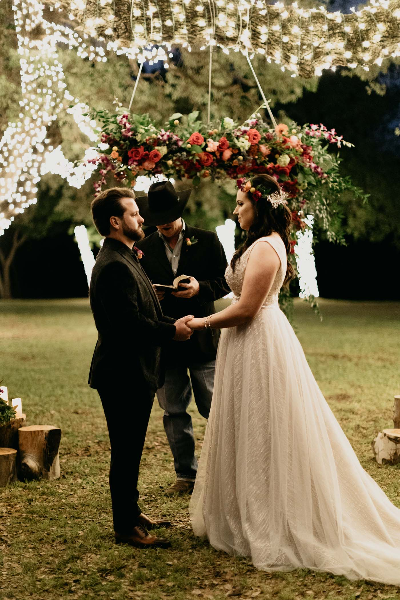 Romantic string light wedding ceremony after dark in Fort Worth