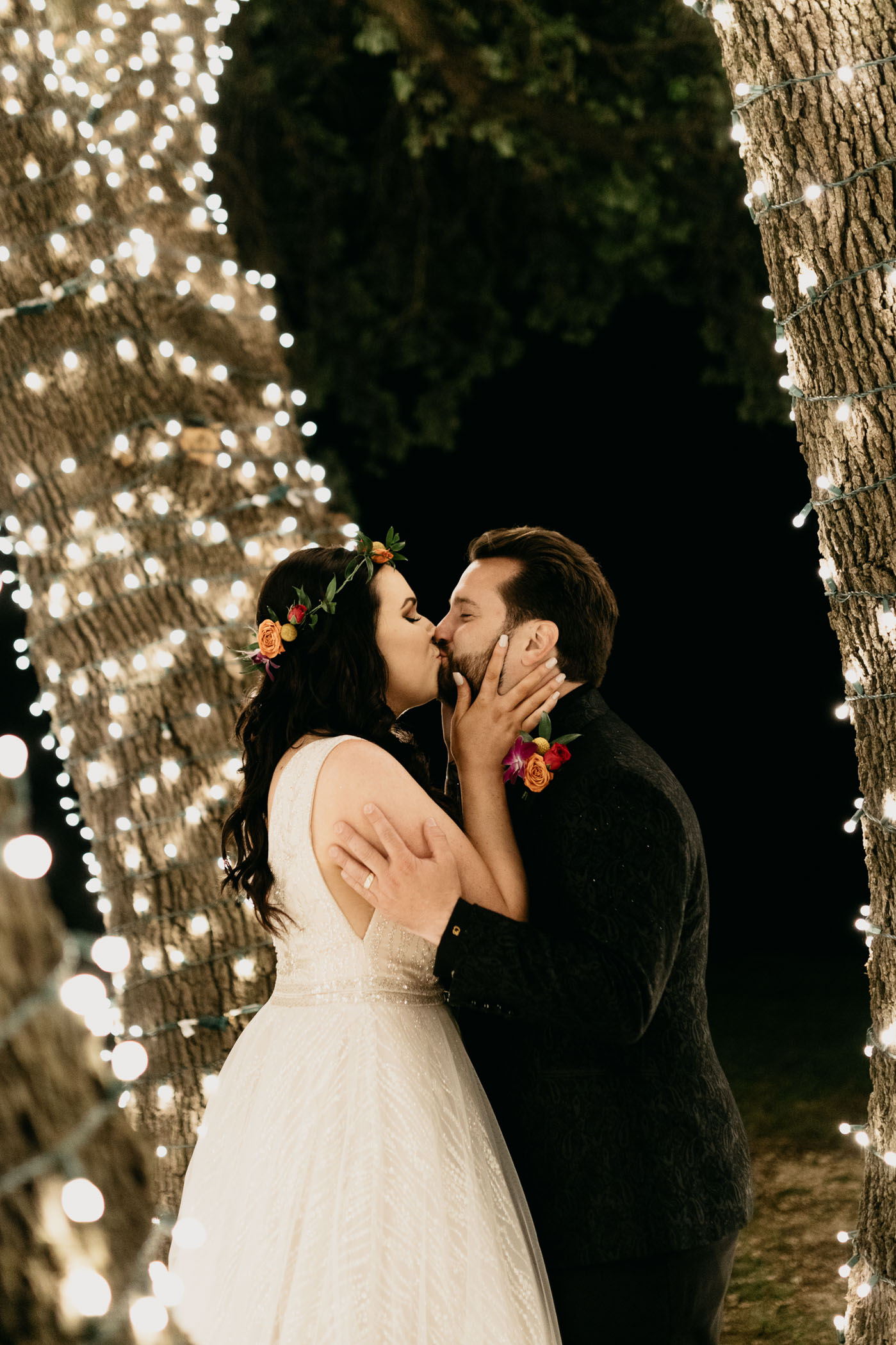 Bride and groom kissing at their night time elopement ceremony