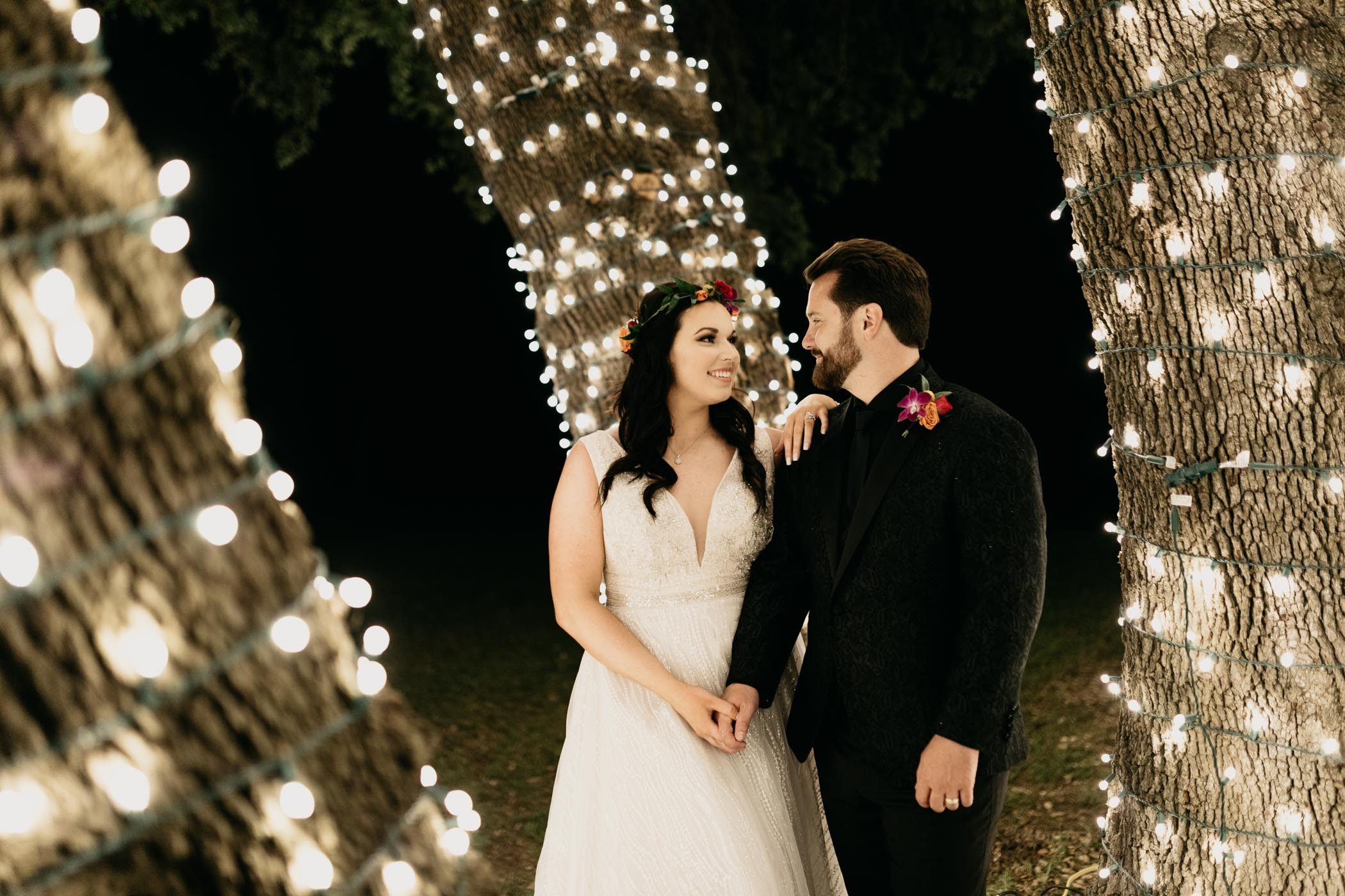 Night time wedding celebrated with string lights and close family