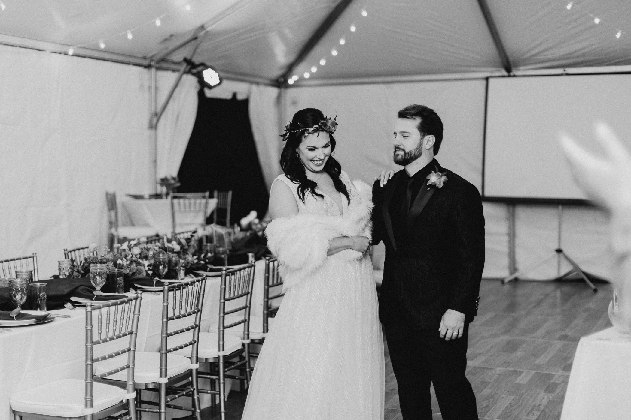 Black and white photo of couple at wedding reception