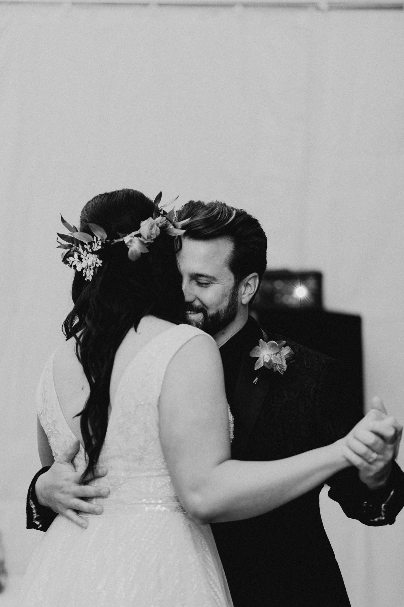 Black and white image of couple sharing their first dance