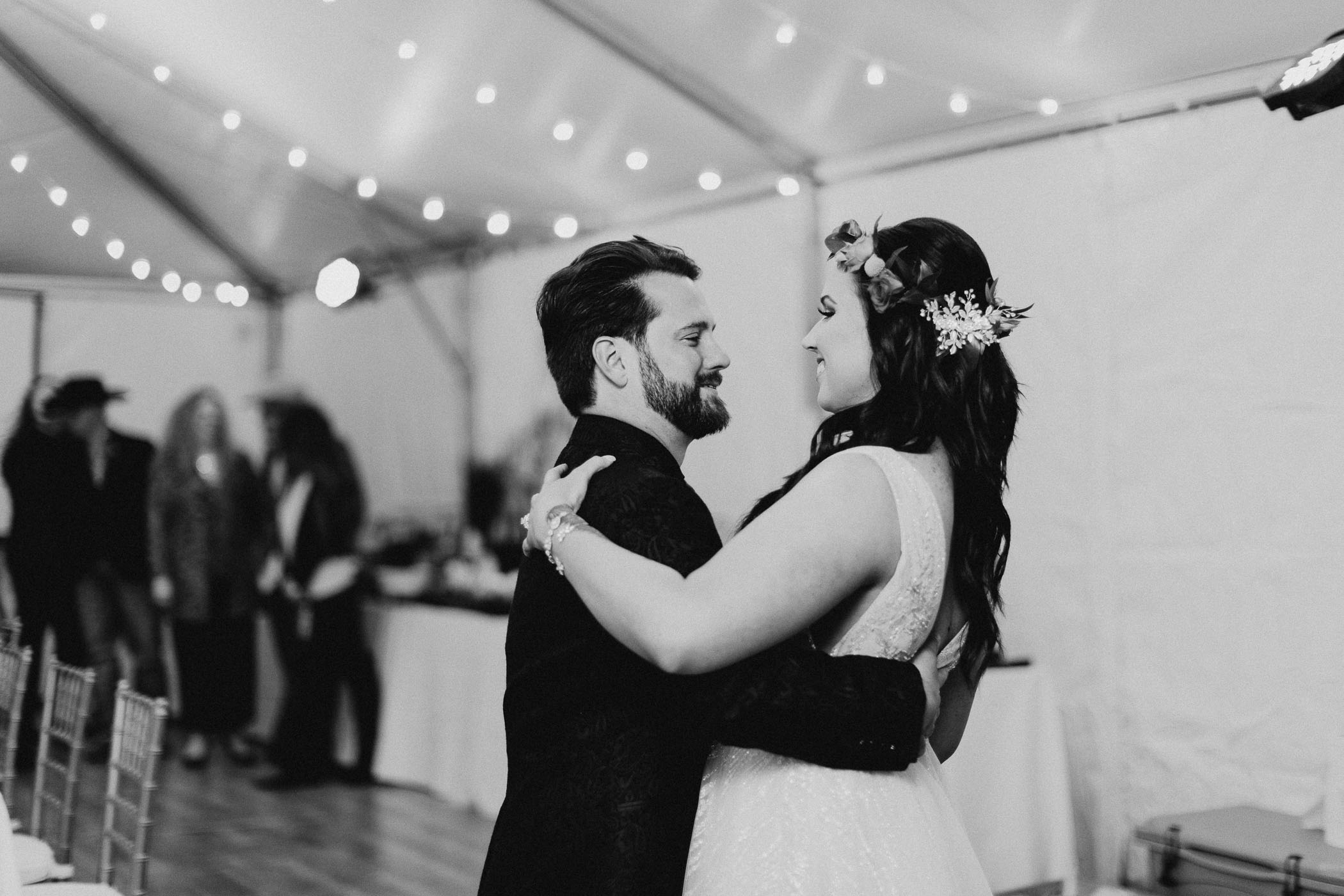 Black and white image of first dance at wedding reception