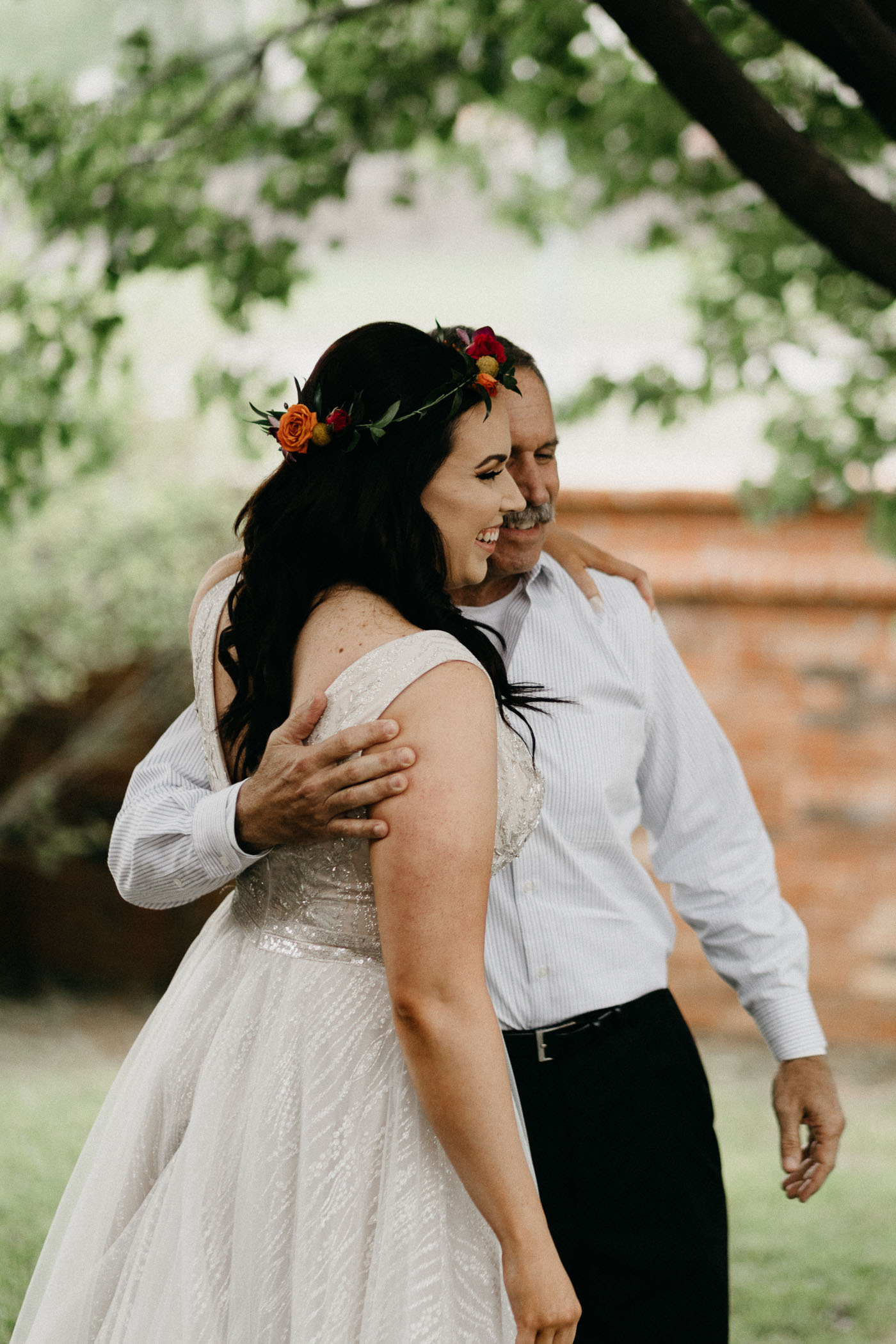 Bride hugging her dad after father daughter first look