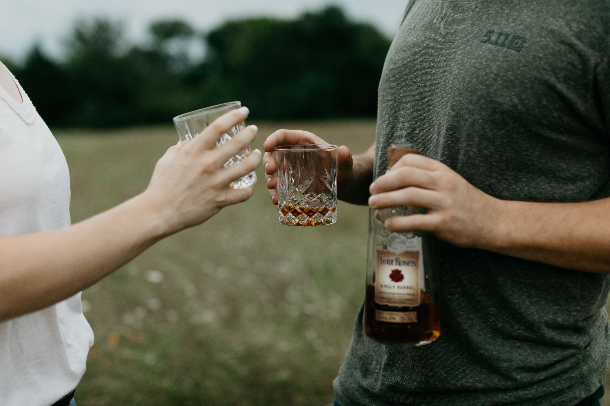 couple drinking four roses whiskey