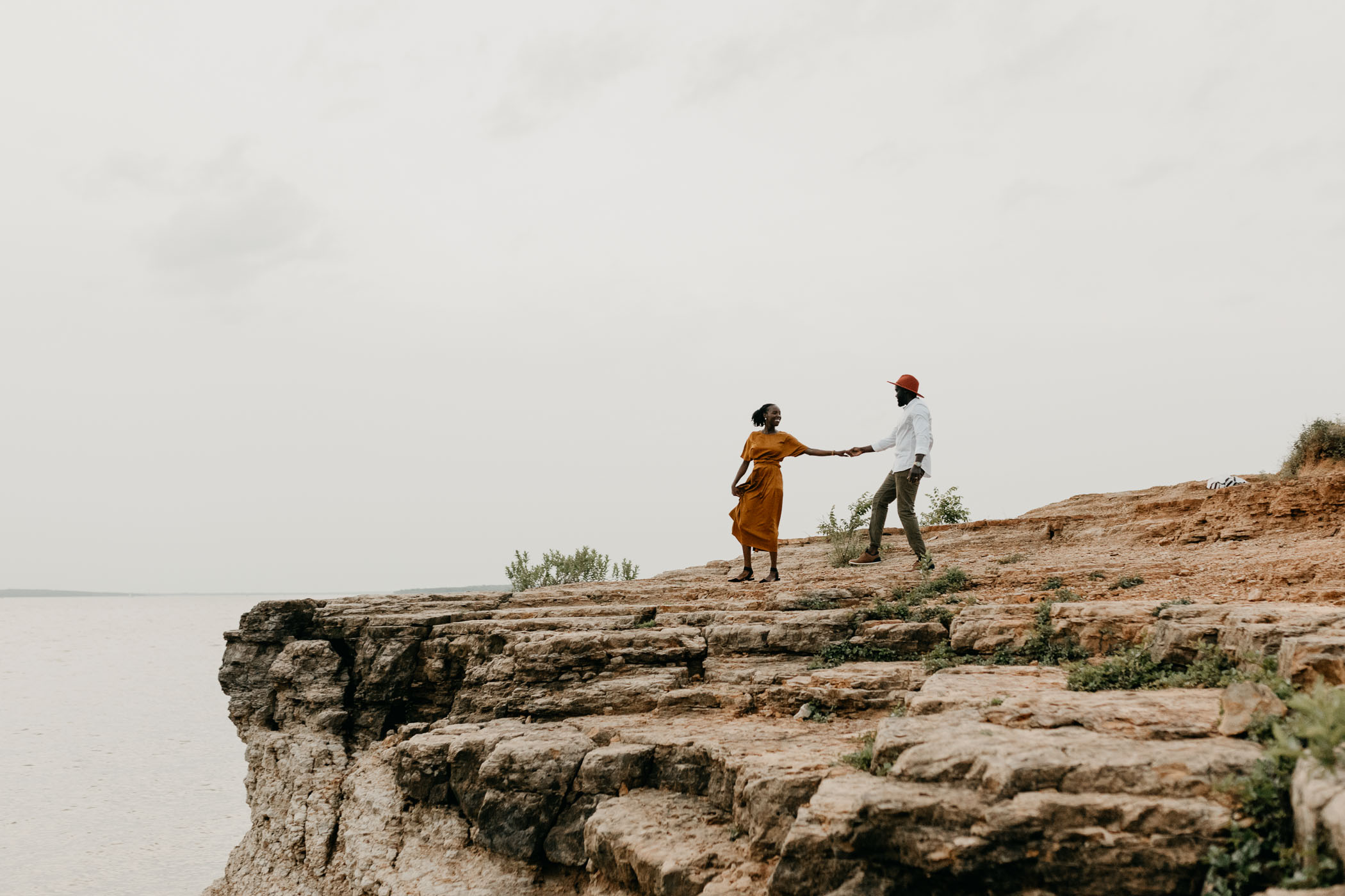 couple walking on a rockledge point in grapevine lake