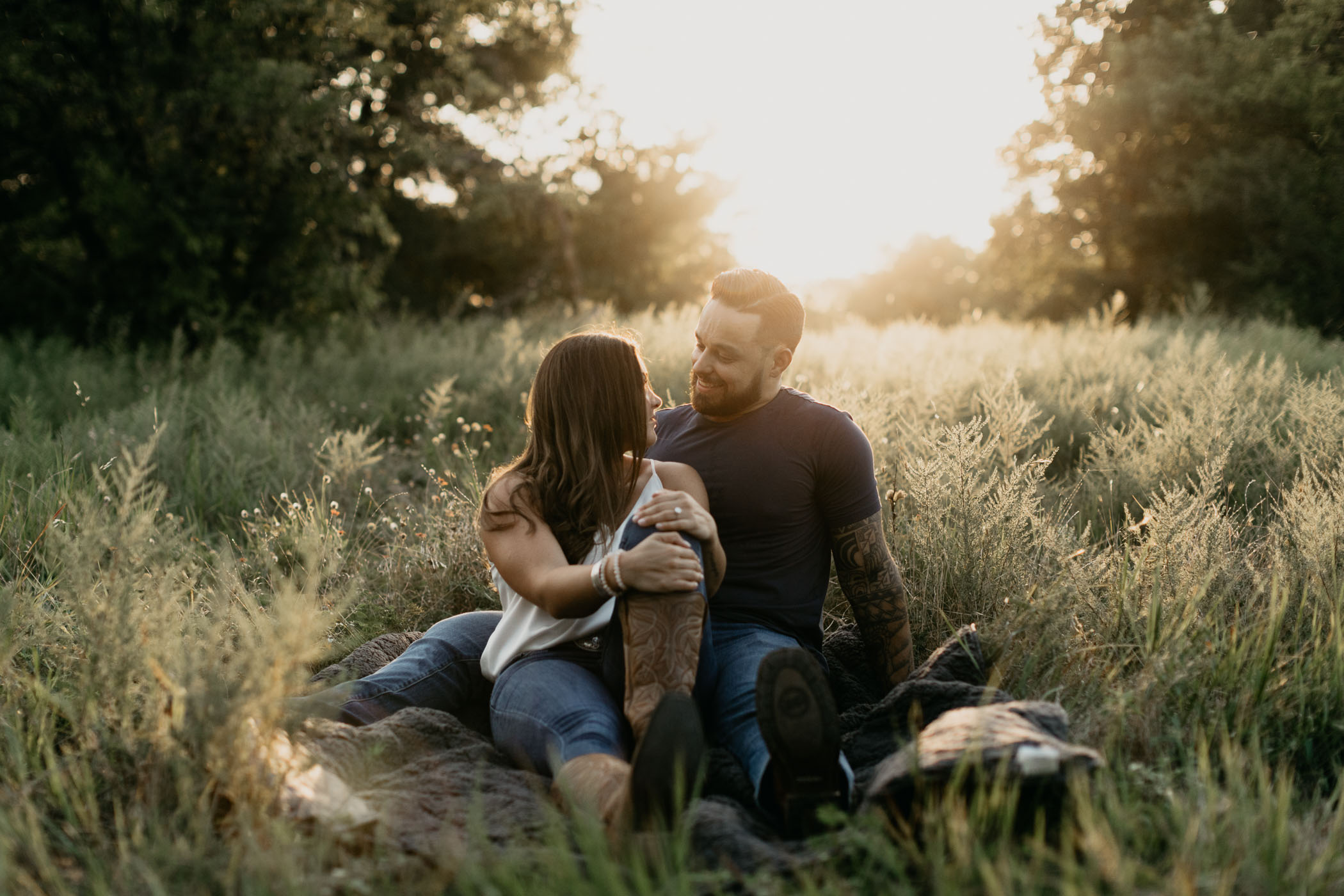 Couple sitting in field in Texas