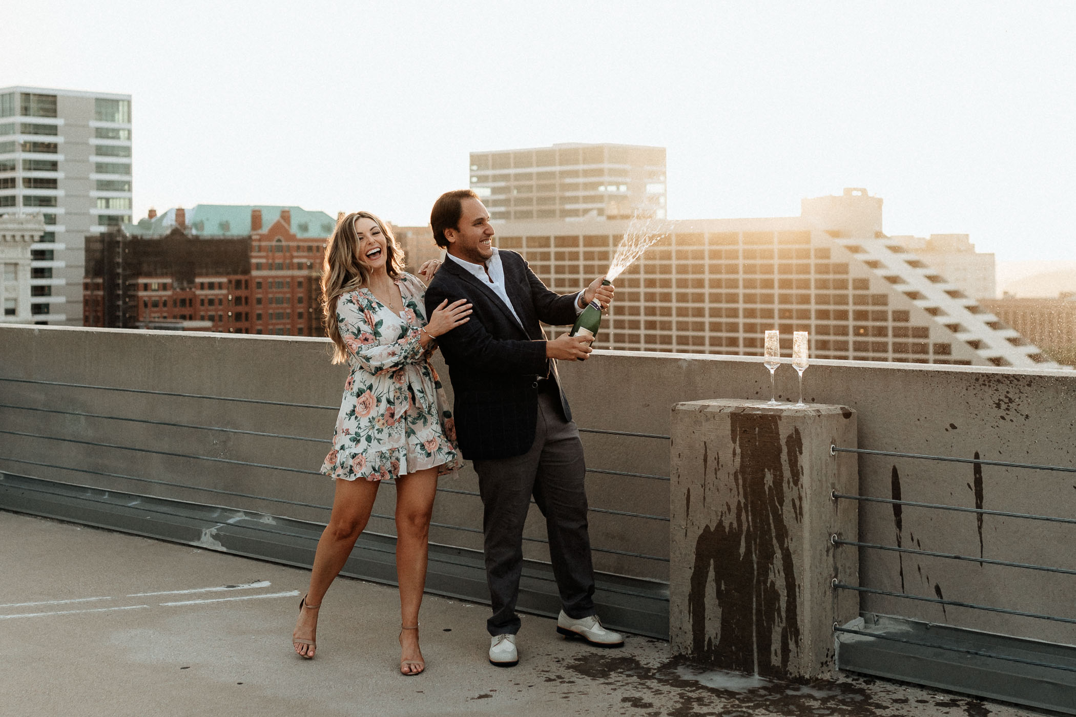 Couple popping champagne on a rooftop in Fort Worth Texas