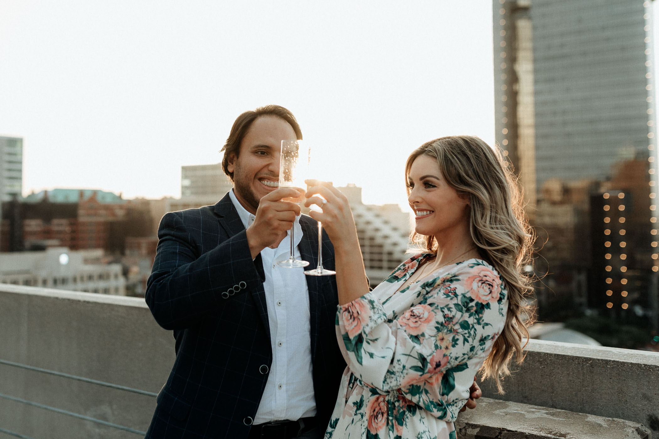 couple celebrating their engagement on a rooftop in fort worth Texas