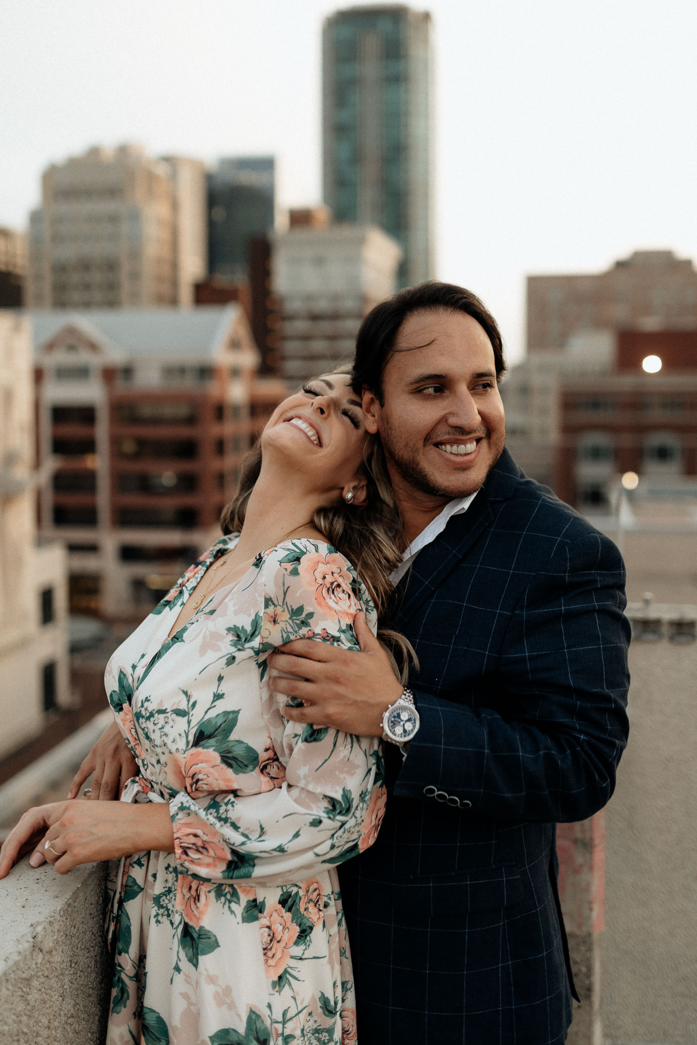 Couple being cuddly and romantic during golden hour engagement sessions own town