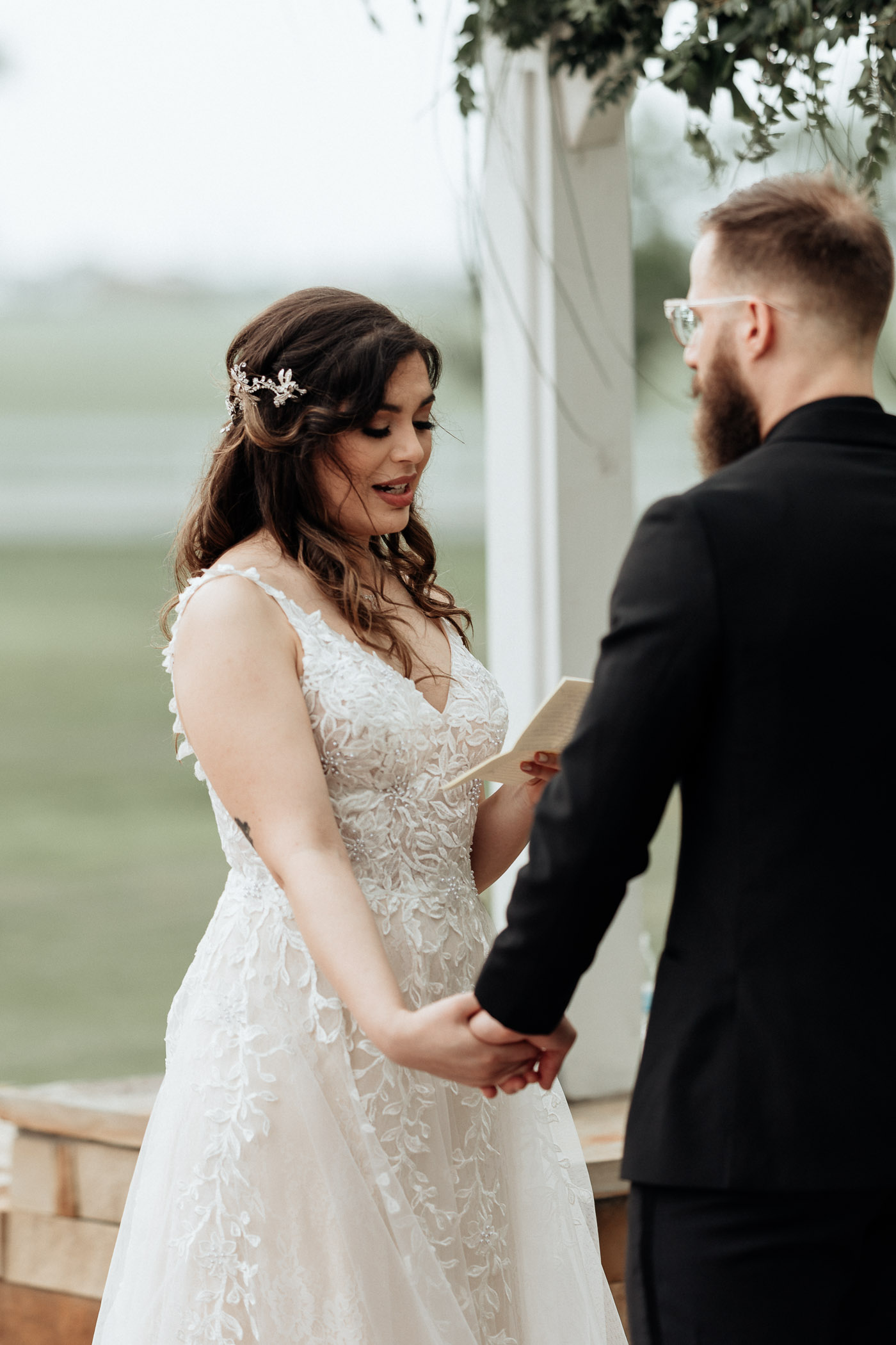 Bride reading her wedding vows during outdoor wedding ceremony in Texas