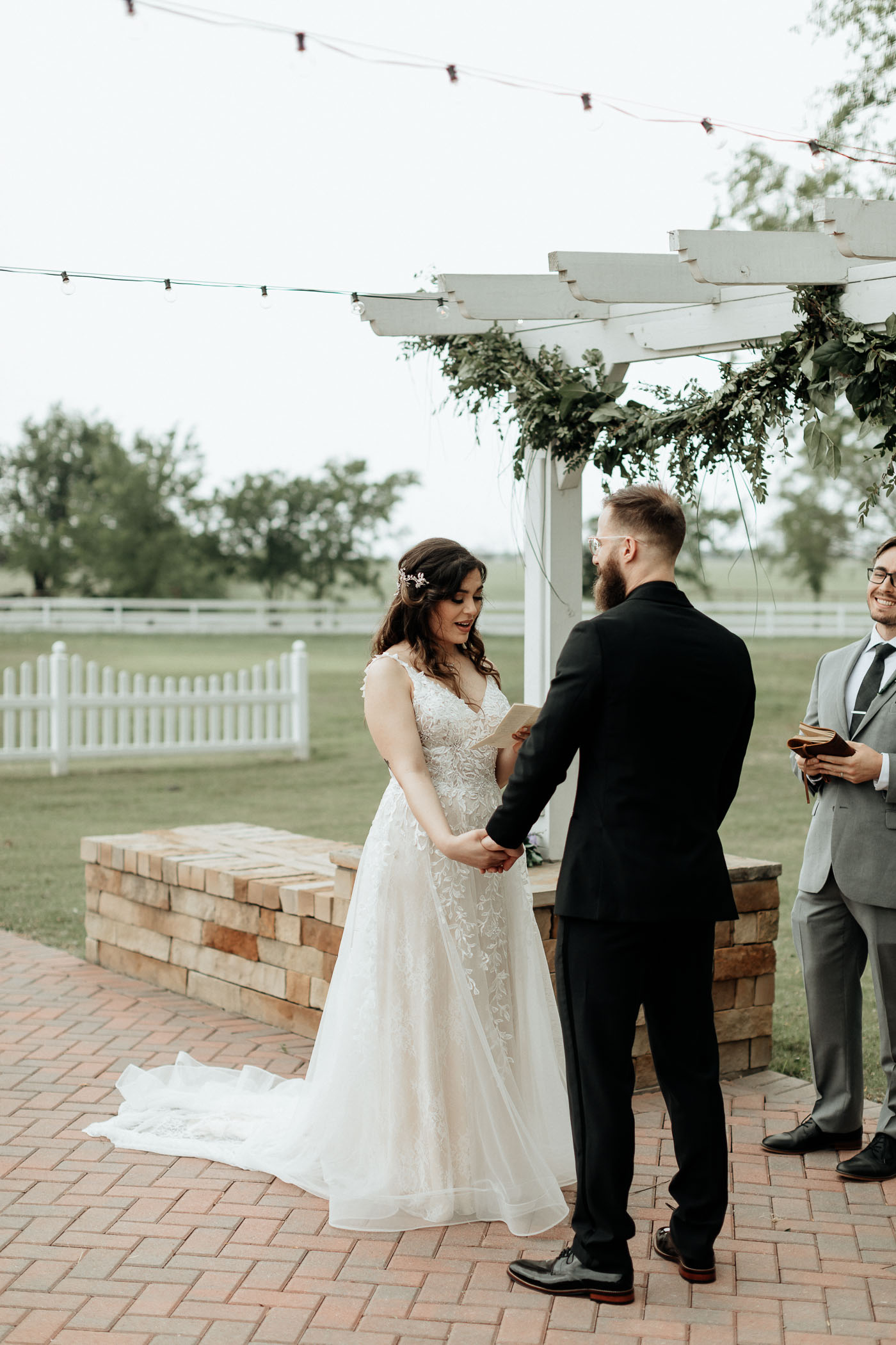 Bride and groom exchanging wedding vows in DFW