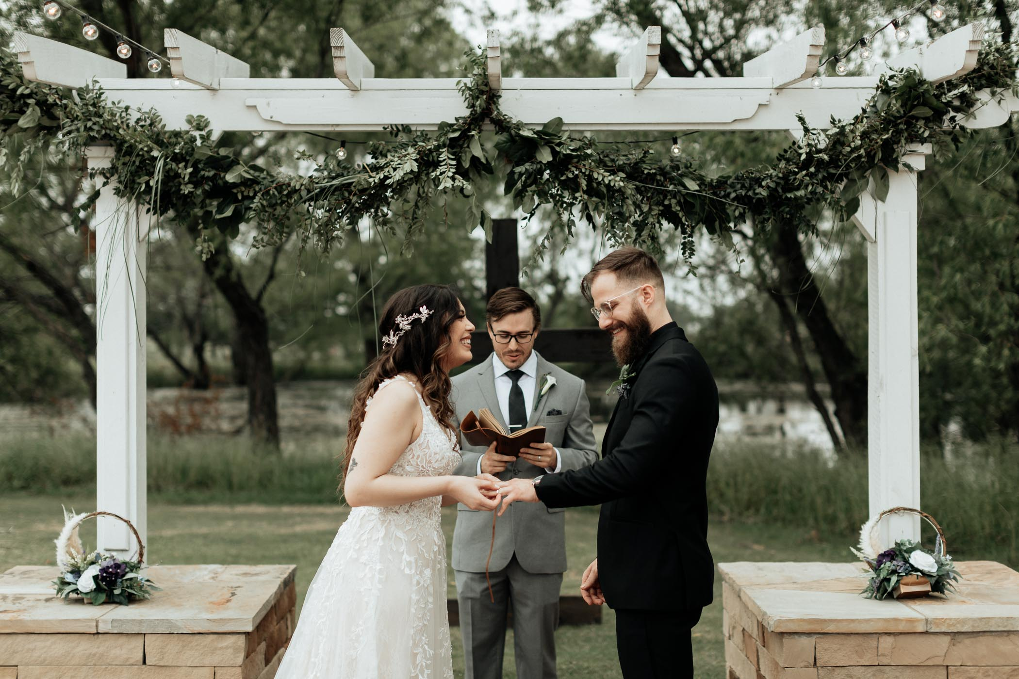 Bride and groom exchanging wedding rings in DFW