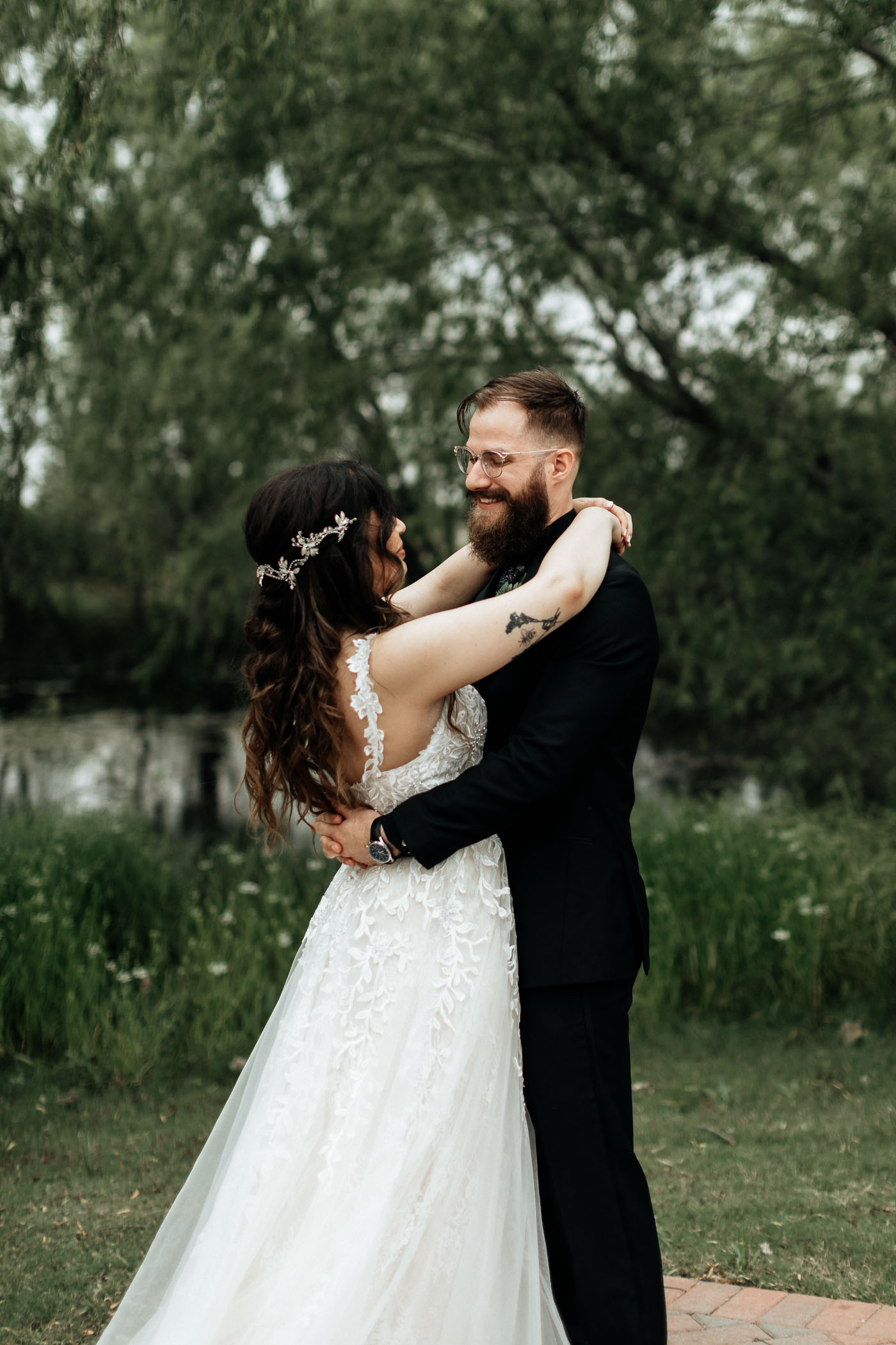 Bride and groom taking photos at natural wedding venue in Texas
