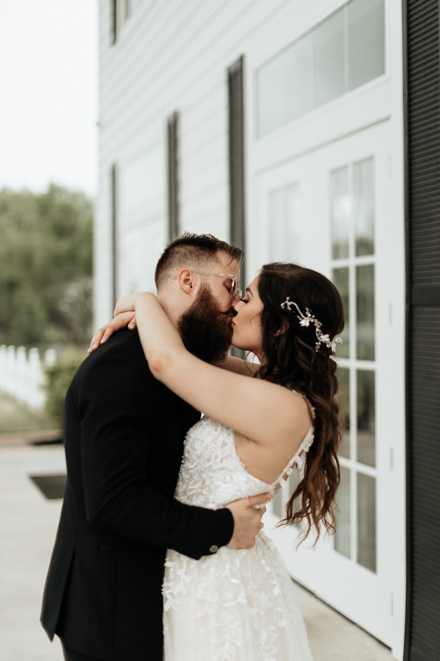 Bride and groom kissing after pandemic wedding ceremony in DFW