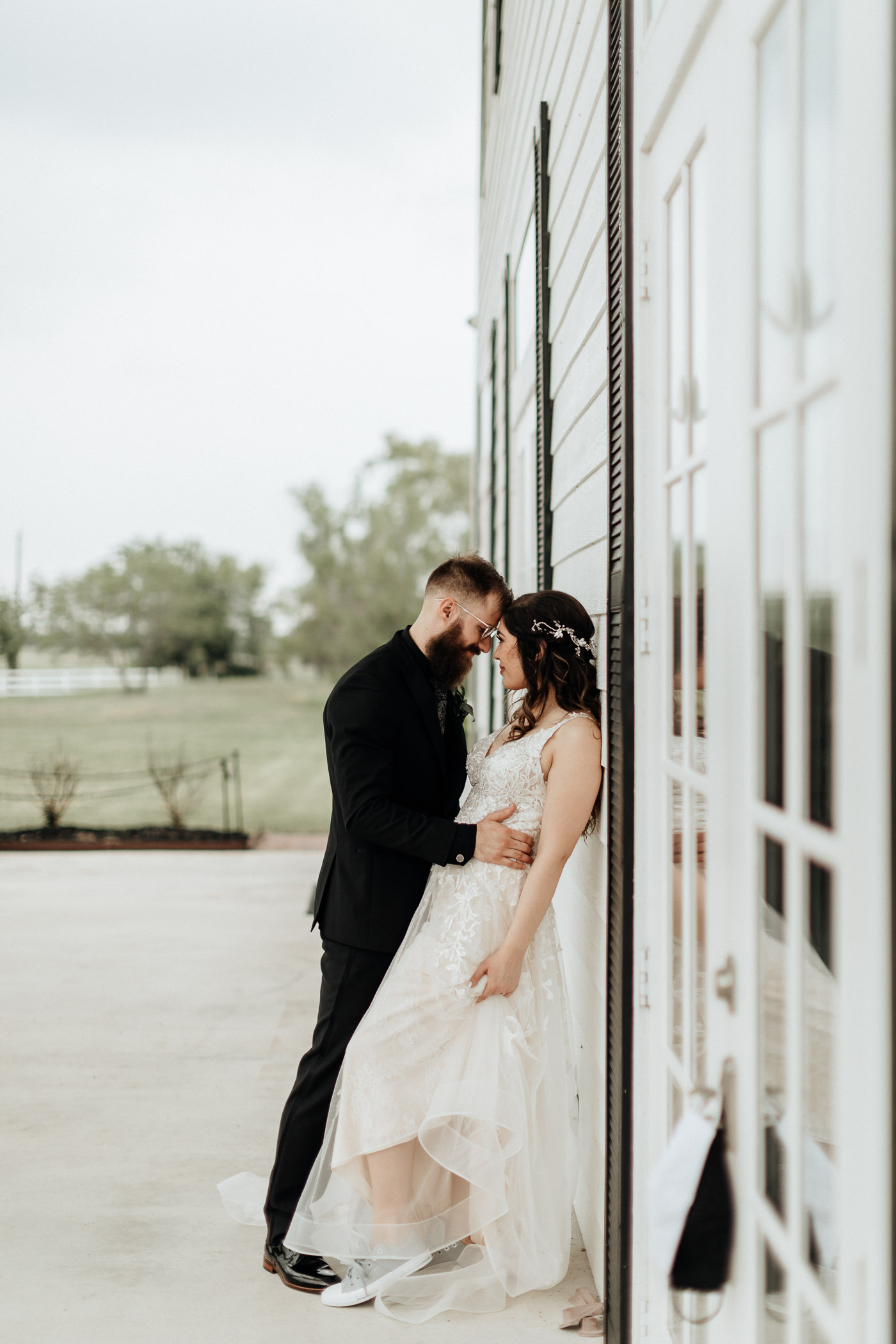 Bride and groom posing romantically for wedding portraits in DFW
