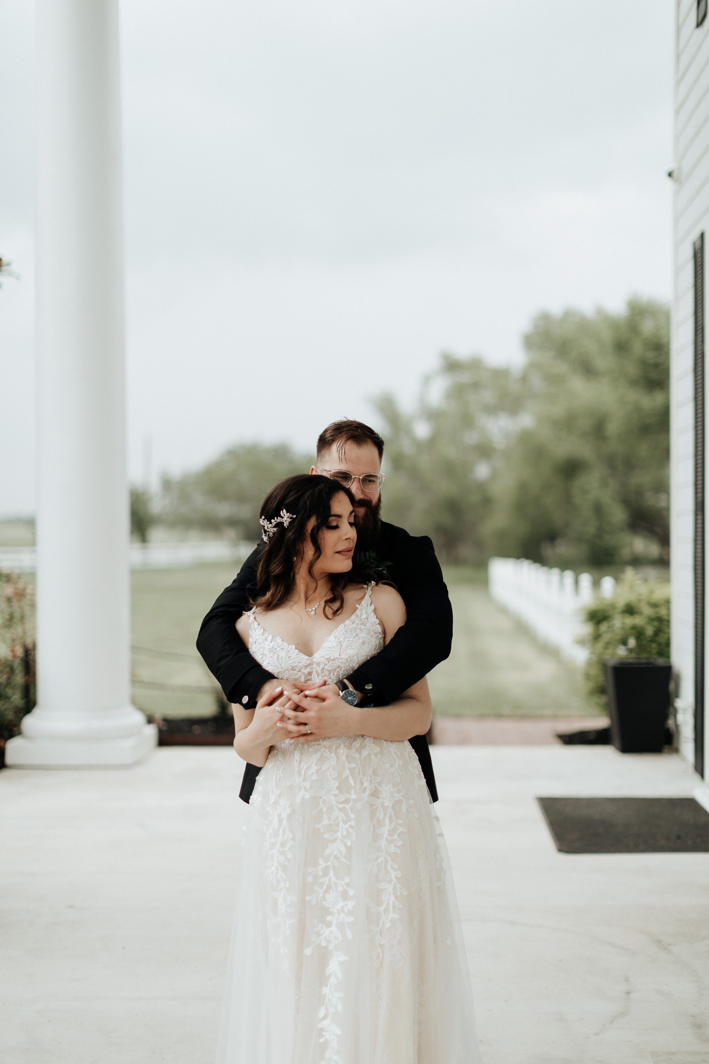 Bride and groom taking wedding portraits in DFW