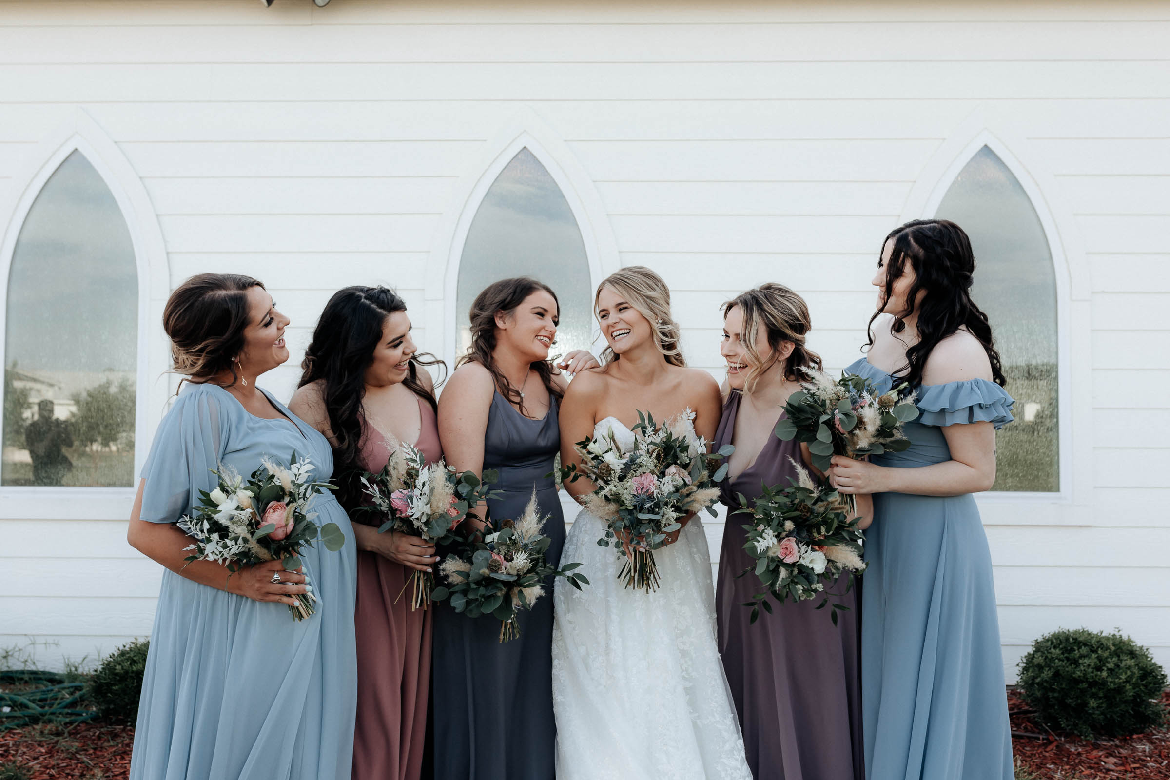 bridal party taking portraits after wedding ceremony