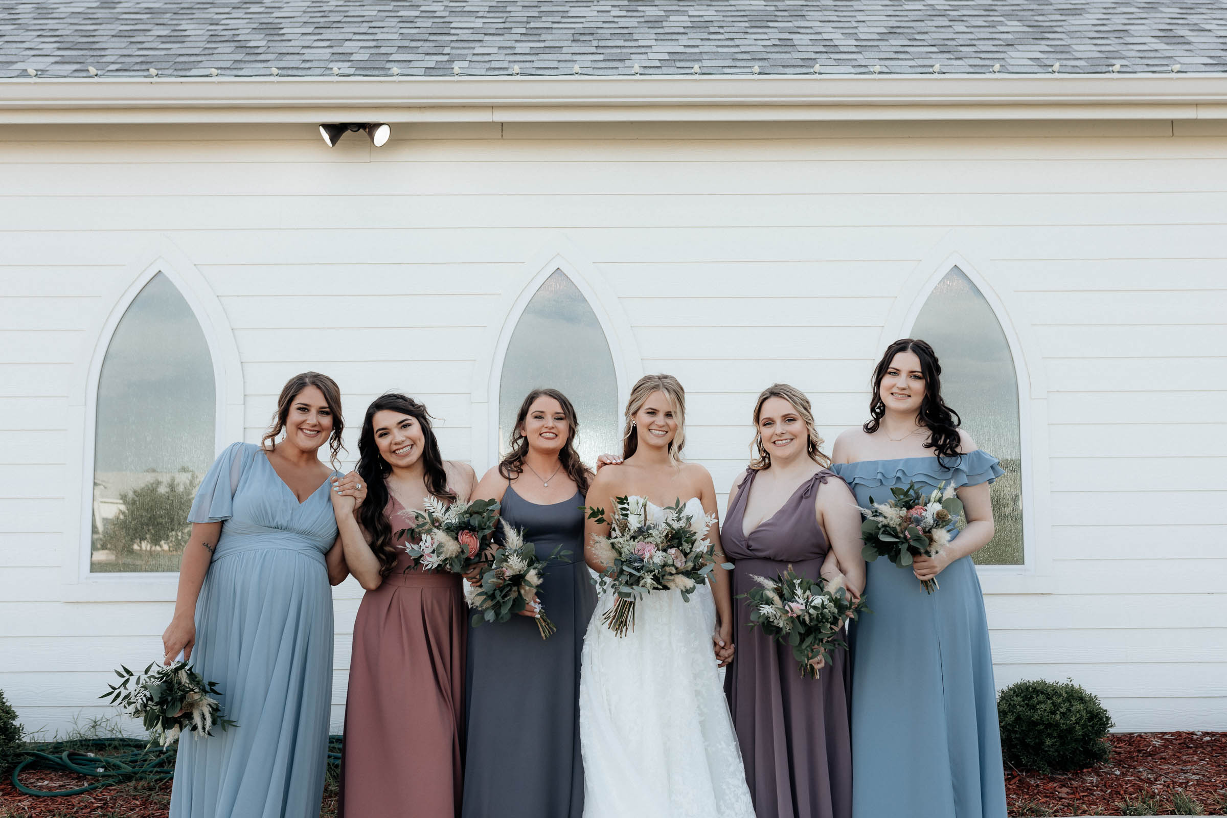 bridesmaids portraits in summer wedding in texas