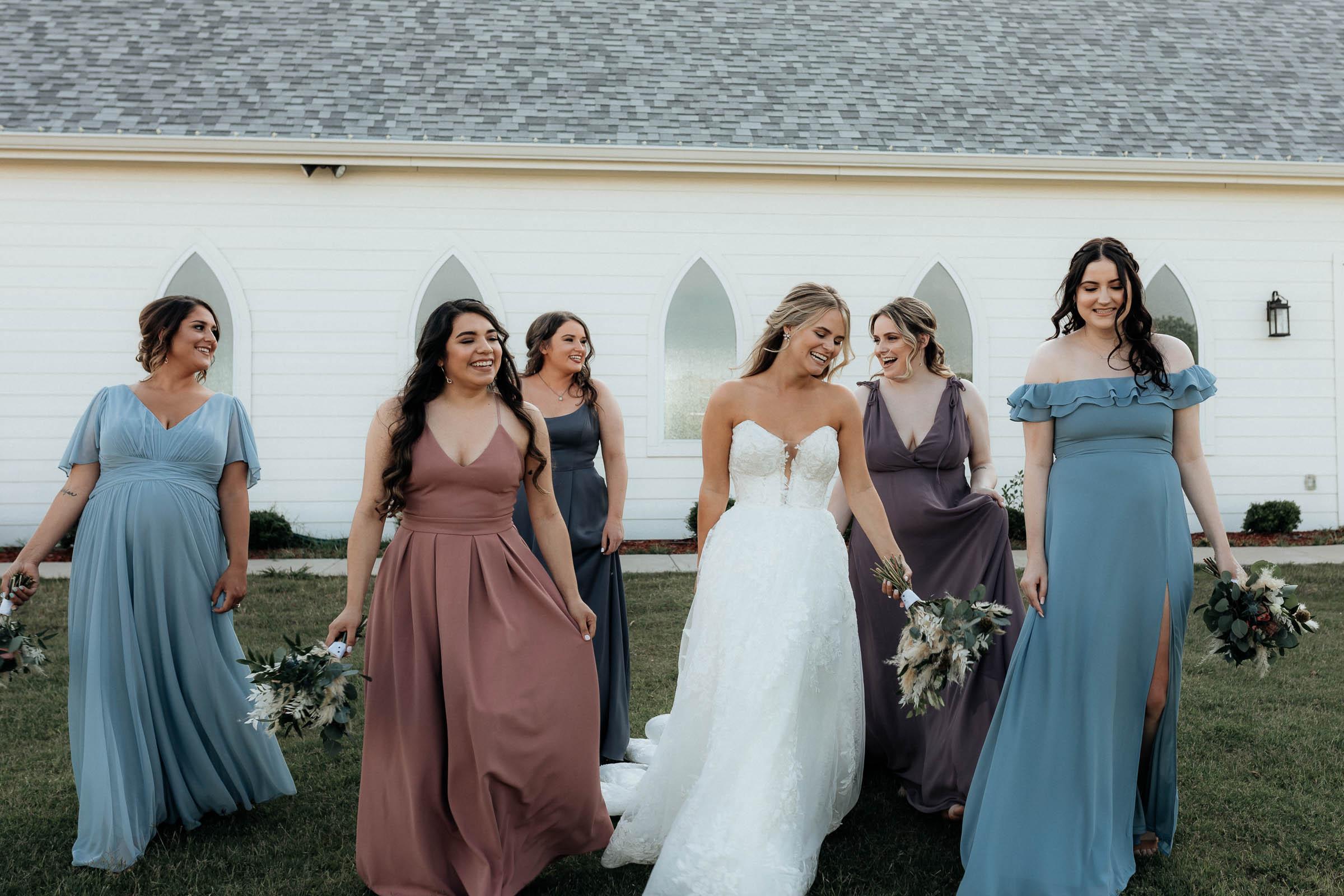 bridesmaids walking and posing for wedding photo