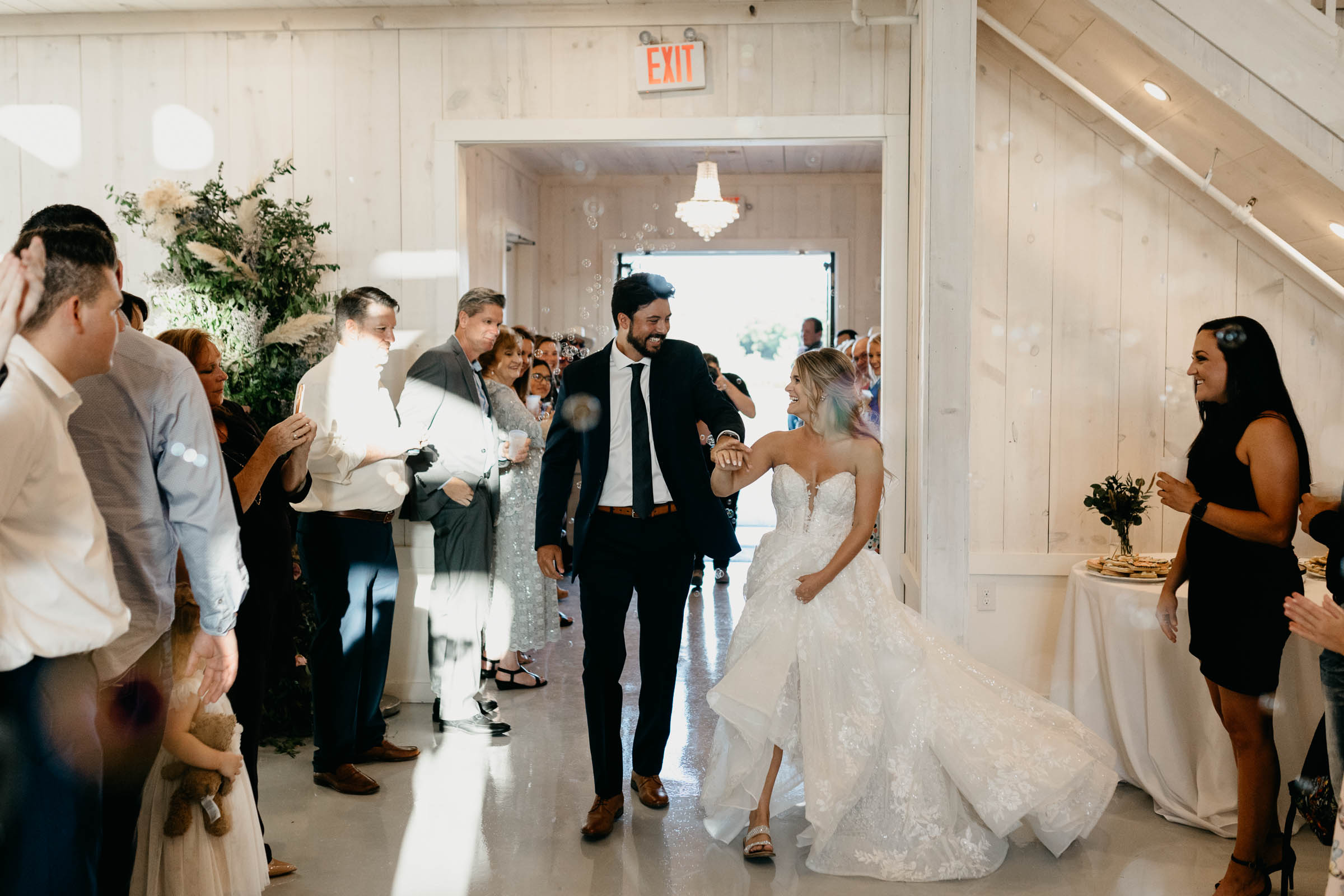 bride and groom walking into reception on wedding day