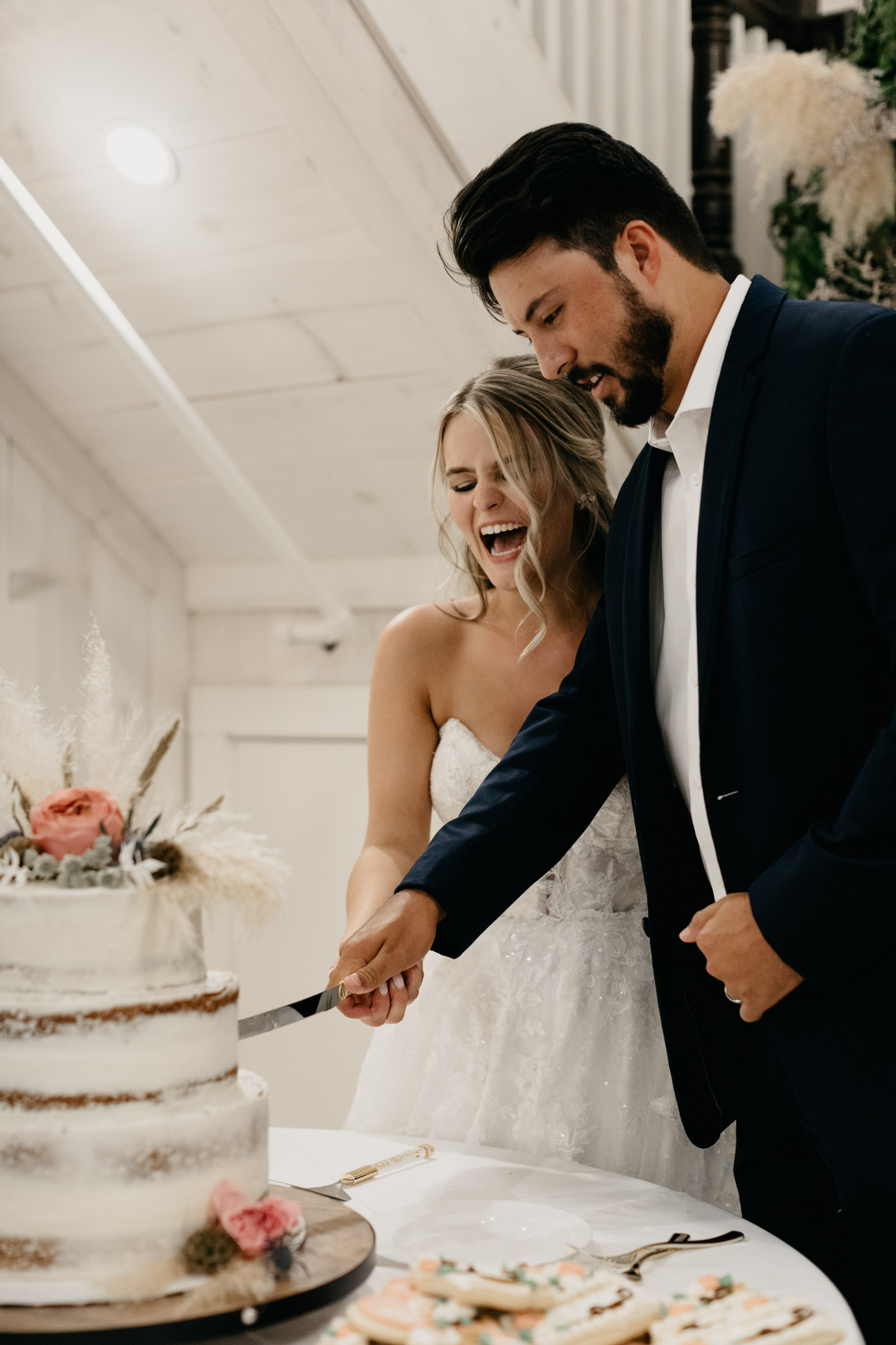 bride and groom laughing in DFW