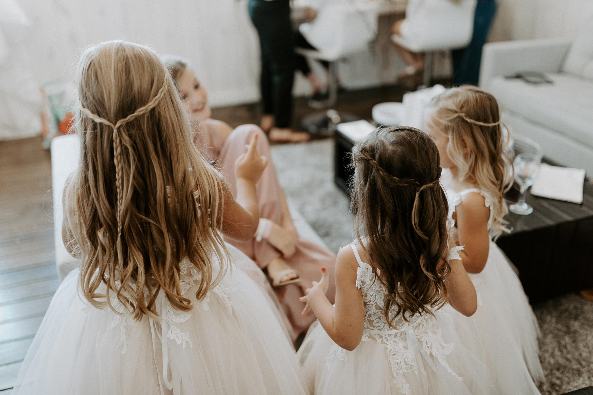 Flower girls playing while bridal party gets ready for Texas wedding ceremony