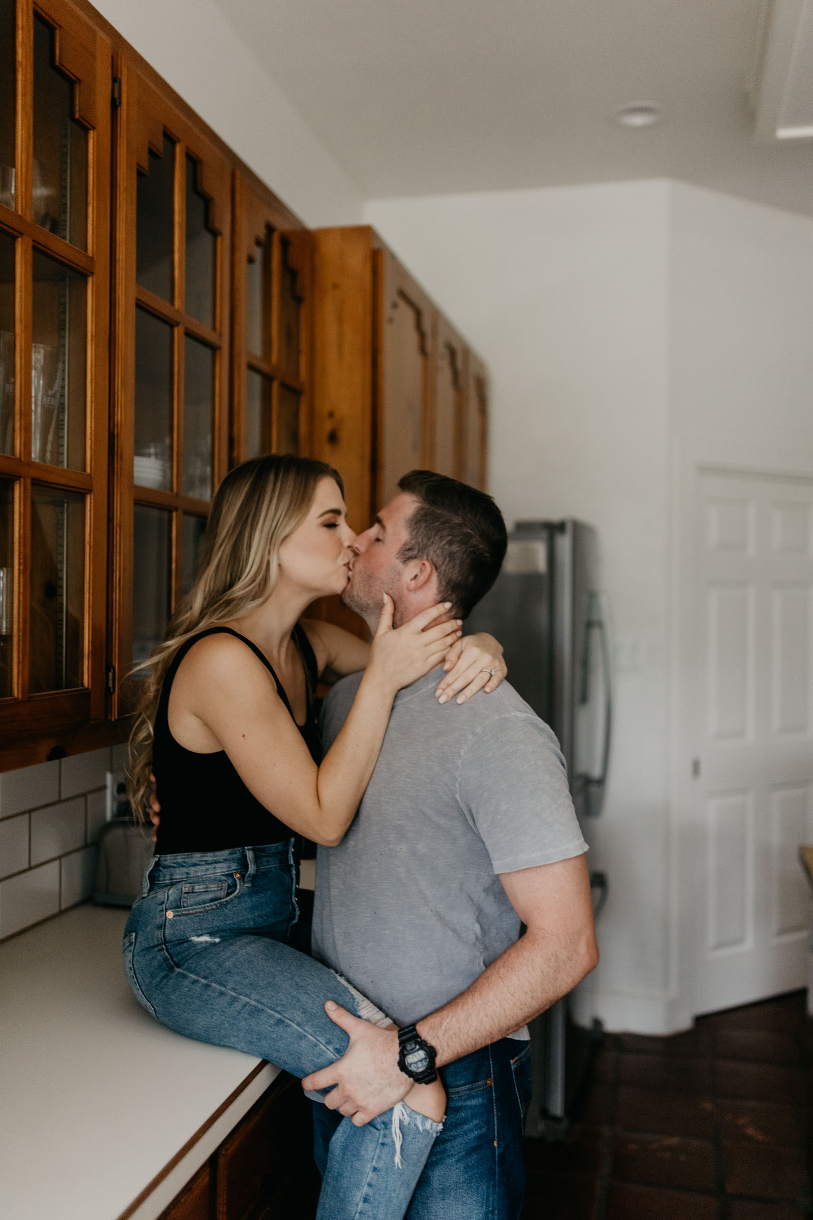 Girl sitting on cabinet for romantic engagement photo