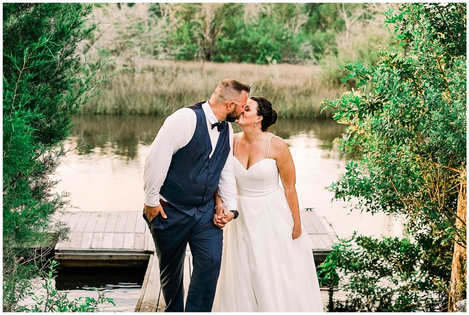 Bride and groom on floating dock