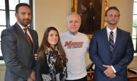 """Marist President Dennis J. Murray wearing the """"Fox Company"""" T-shirt that the Marist Student Veterans Organization (MSVO) is selling to support the Gulliver's Travel fundraising campaign. From left, Owen Daly '05, Marine veteran and advisor to MSVO, Marine veteran and MSVO President Britany Diesing '16, President Murray, and Matt Plumeri '16."""