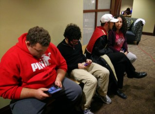 Students playing on their handheld games