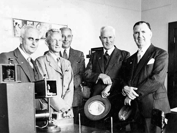 Politicians visiting Awarua Radio c1956. From left: Invercargill MP Ralph Hannan, Awarua Radio Superintendent John Houlihan. At far right Prime Minister Sid Holland