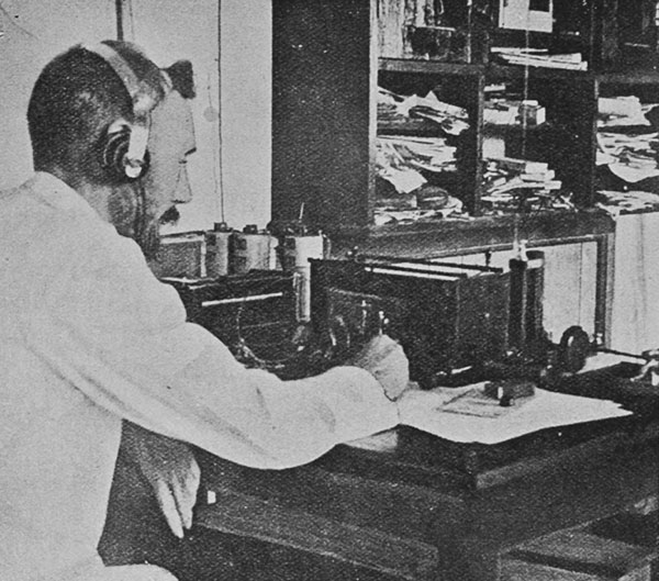 The first wireless telegraph station in the South Sea Islands: the operator at Papeete, Tahiti, receiving a message.