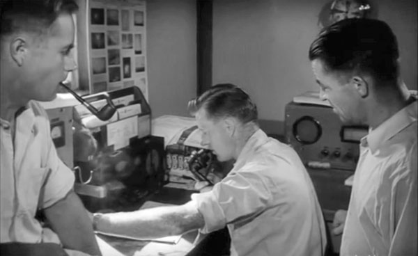 Cuvier Island Lightkeepers at their radiotelephone in 1956