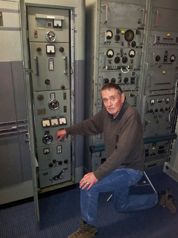 Former Himatangi Radio technician Chester Clark with one of the station's DS12 transmitters (left) and associated drive units at the Museum of Audio Visual Technology in Foxton, c2012