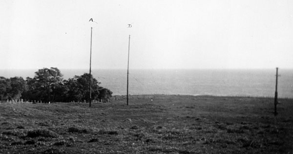 Raoul Island Radio, April 1950: Poles A and D (labelled on photo) and wooded gully west of poles
