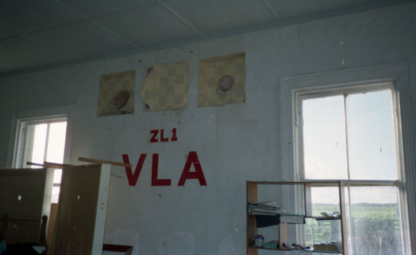 Interior of the eastern end of the operating building at Awanui Radio. Still visible are three areas where feedlines passed through the wall too the tower. This area had been rented by radio amateurs for a month in 1980 for special event station ZL1VLA