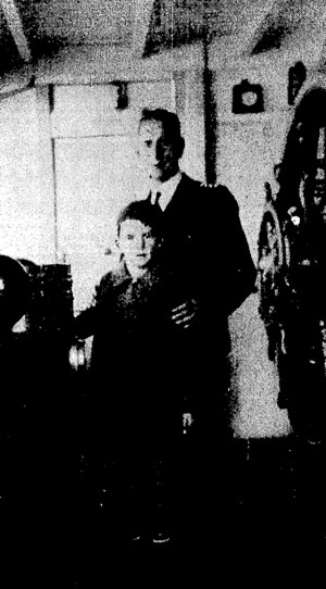 James Miller, master of the Holmwood, with young passenger Tom McMahon in the steamer's wheelhouse