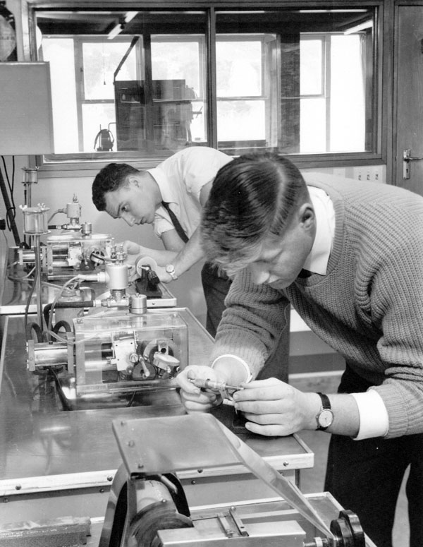 Brian Fanning (left) and Dave Burger using grinding machines