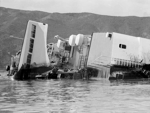 Wahine lies on her starboard side, stained by oil escaping from her tanks