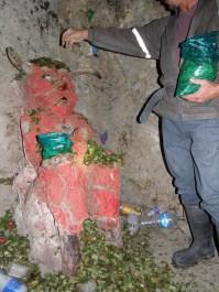 Offering coca leafs to El Tio