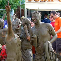 Muddy people at Glastonbury 2007