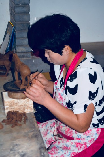 Chinese artisans carving replicas of the horses of the Terracotta warriors