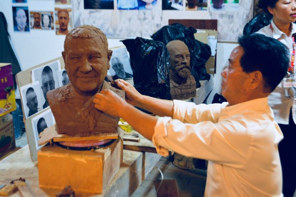 Chinese artisans carve custom busts available at the studio where they make Terra-cotta warrior reproductions
