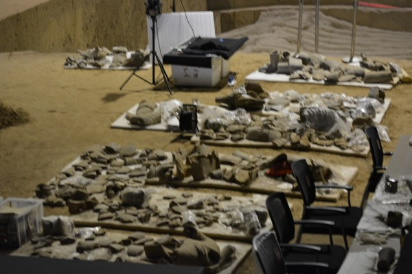 crumbled pieces of Shaanxi terracotta warriors laid out for restoration