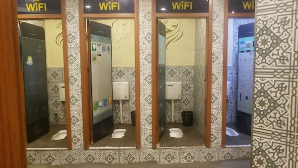 squat toilets - navigating bathrooms when you travel - travel blogger - bathrooms - Mark and Chuck's Adventures