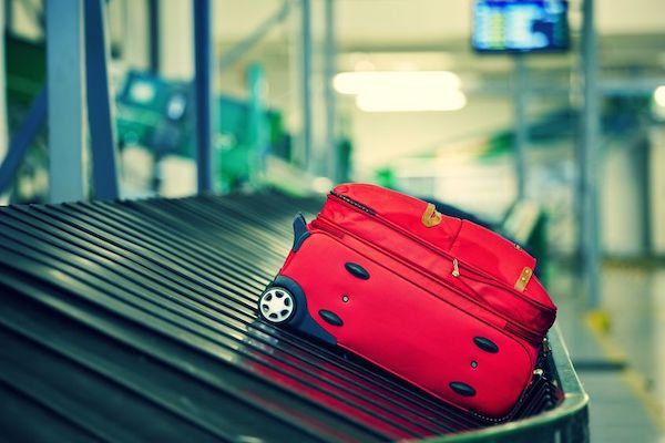 lost luggage - what happens when the airline loses your luggage - cross packing your luggage - suitcase on airline belt