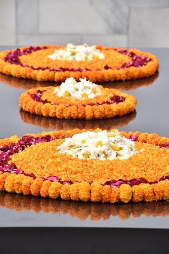 Raj Ghat - Gandhi - Gandhi memorial - New Delhi - wreaths of marigolds roses and daisies